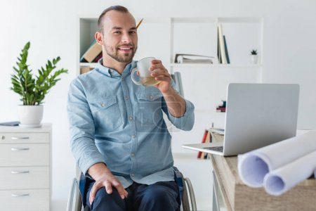 disabled businessman drinking coffee