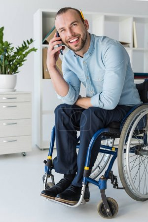 businessman in wheelchair on phone