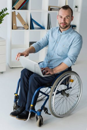 businessman in wheelchair using laptop