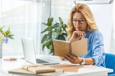 businesswoman with diary and laptop