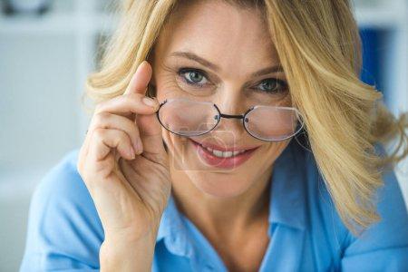 mature woman in eyeglasses