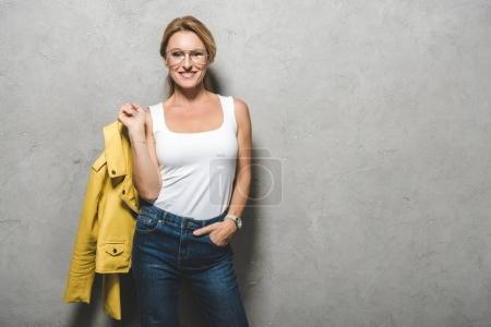 woman with yellow leather jacket