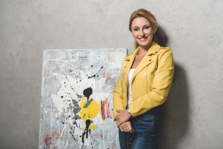 blonde woman with painting