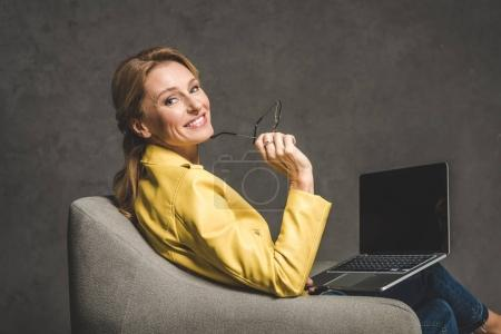 woman using laptop with blank screen