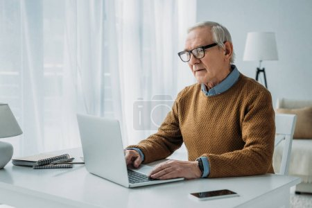 Photo for Senior confident man working on laptop - Royalty Free Image