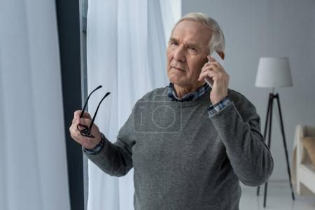 Senior confident man making a phone call