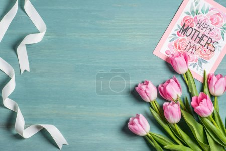 Photo for Top view of beautiful pink tulips and happy mothers day greeting card - Royalty Free Image