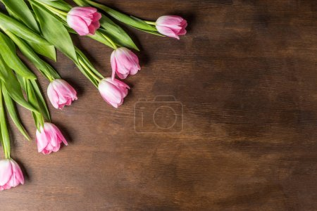 Photo for Top view of Mother's day holiday composition with beautiful pink tulips on wooden table - Royalty Free Image