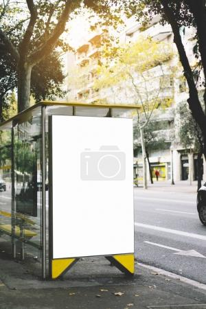 Photo for Blank advertising light box on bus stop, mockup of empty ad billboard on sun day bus station, template banner on background city street for poster or sign in Barcelona, afisha board and taxi car - Royalty Free Image