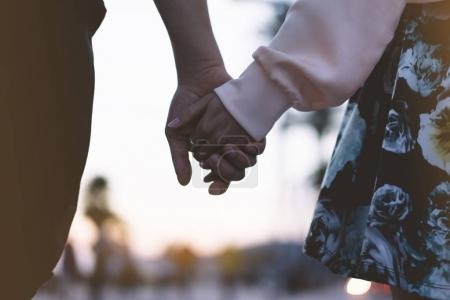 Couple holding for hands
