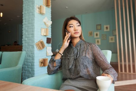female talking on a mobile phone