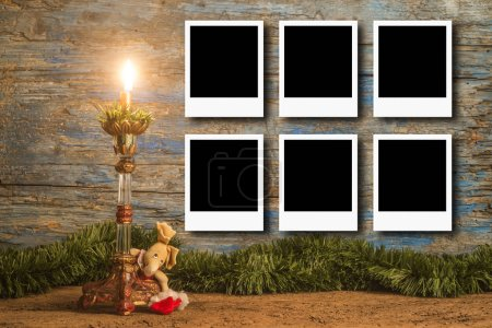 Photo for Christmas cards, vintage candle and Christmas decoration with empty picture frame for put sixt photos - Royalty Free Image