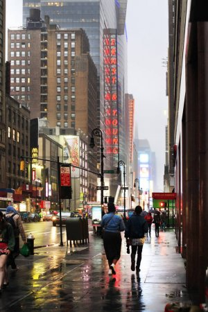 Photo for New York, USA - May 20, 2013: Time Square at night in the rain. The site is regarded as the world's most visited tourist attraction with nearly 40 million visitors annually. - Royalty Free Image