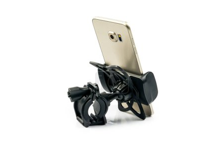 Photo for Back side view of new universal phone holder for car motorbike and bike with installed gold smartphone. Isolated on white background - Royalty Free Image
