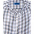 Men's classic white with blue and brown plaid folded cotton shirt with long or short sleeve and blue blank label isolated on white background.
