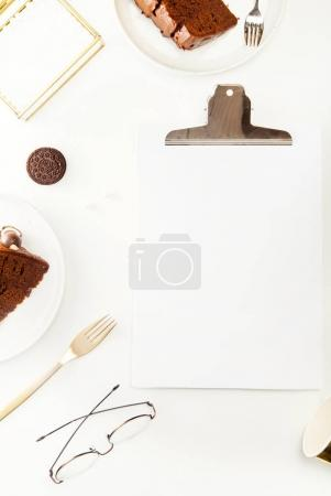 empty paper, chocolate cake and cookies
