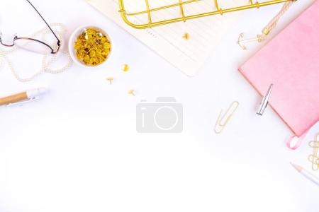 notebook, glasses and golden accessories