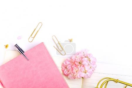 Photo for Notebook, pen and pink flowers on white background - Royalty Free Image