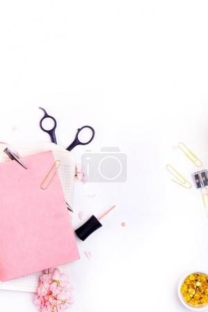 Workplace mockup with pink notebook