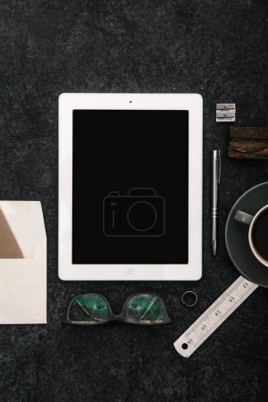 Mock up with tablet, glasses and cup of coffee