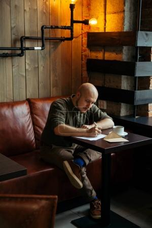 fashionable man sitting in cafe