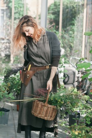 lady working at the greenhouse