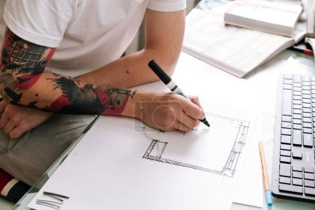 Young interior designer working at home