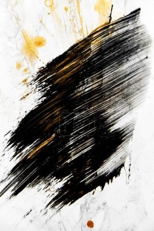 abstract mashed stain of black color paint on white background with golden spots
