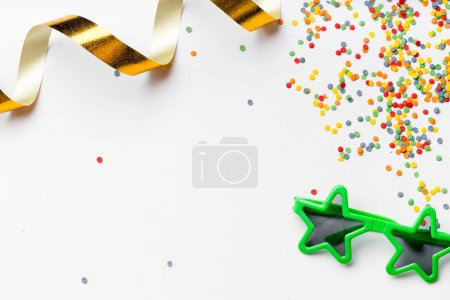collection of colorful party accessories isolated on white background, close-up