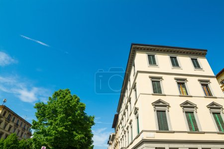 white building and blue sky in Florence