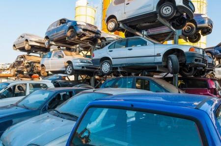Cars stacked in a car breaker junkyard