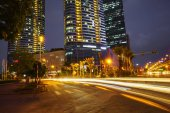 Night scene of modern city with light trails.