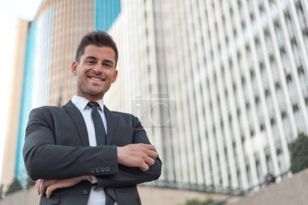 Photo for Businessman crossed arms smiling - Royalty Free Image