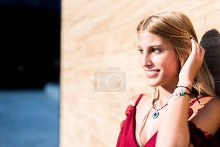 happy beautiful blonde woman smiling looking at the camera and posing