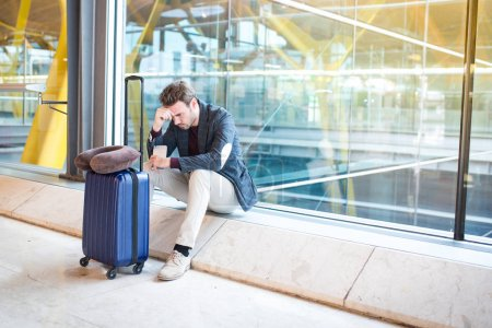 Man unhappy and frustrated at the airport his flight is canceled