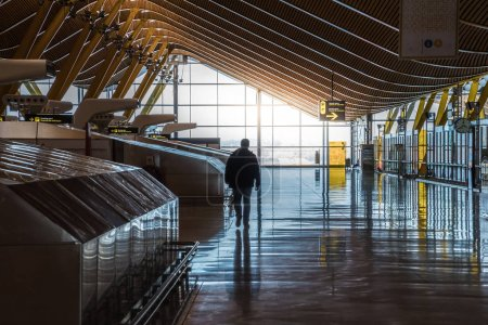 airport terminal with people moving silhouettes and sun ray