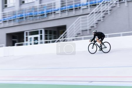 A cyclist riding a velodrome at high speed. Bicycle training. Sport