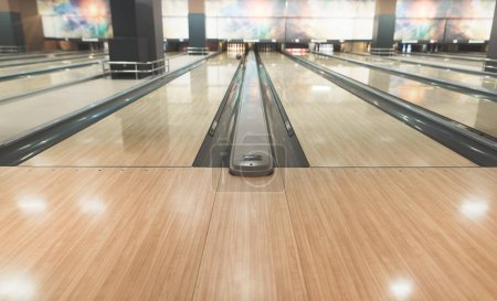Empty yellow track for bowling. Active leisure for bowling.