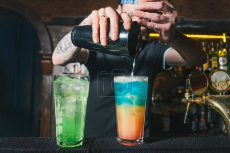 Photo for Cropped image of bartender mixing ingredients of alcoholic cocktail - Royalty Free Image