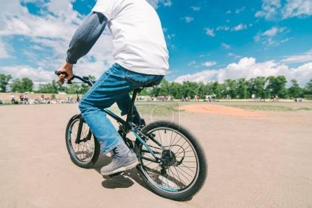 Photo for Adult man rides a baby bike. A man steals a bicycle - Royalty Free Image
