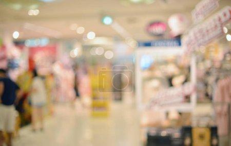 Photo pour Fond flou abstrait des magasins de détail dans le centre commercial - image libre de droit