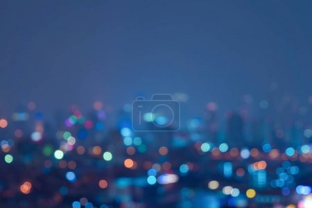 Photo for Bokeh background of skyscraper buildings in downtown. Urban city with lights, Blurry photo at night time.  illuminated Cityscape - Royalty Free Image