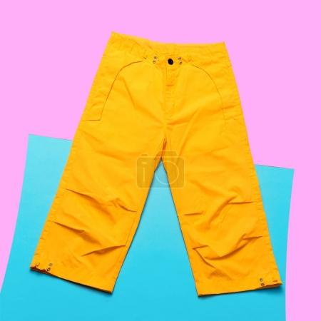 Yellow pants hipster trend. Minimal design fashion