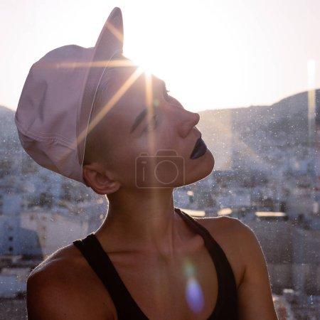 Girl in a stylish cap. Urban Tomboy style fashion vibes