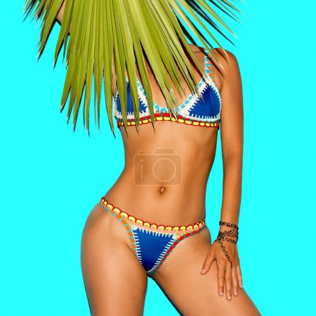 Model in fashion bikini and accessories. Tanned body. Beach styl