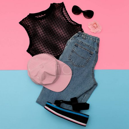 Vintage blue jeans and  stylish black top. Trend accessories gla