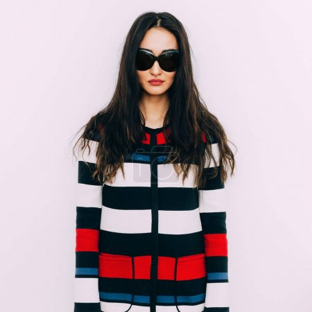Photo for Brunette model in fashion striped coat and stylish sunglasses. Spring fashion - Royalty Free Image