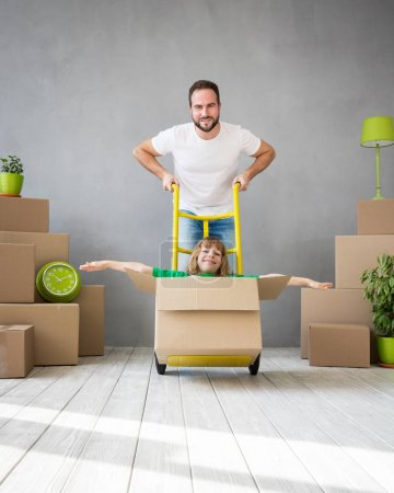 Photo for Happy family playing into new home. Father and child having fun together. Moving house day and express delivery concept - Royalty Free Image