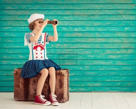 Child pretend to be sailor