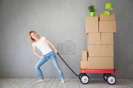 Photo for Happy woman playing into new home. Moving house day and express delivery concept - Royalty Free Image